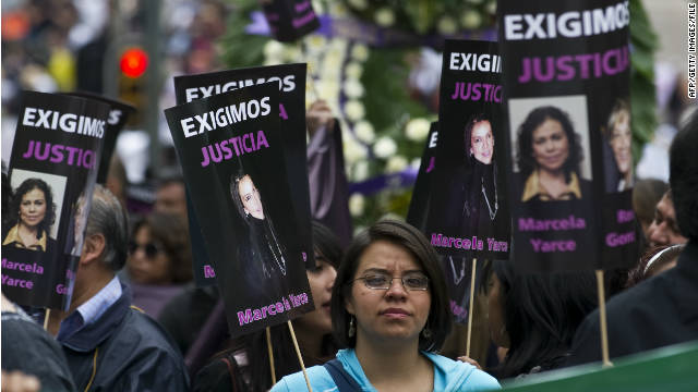 People hold signs during a protest against violence towards journalists in Mexico, on September 11, in Mexico City.
