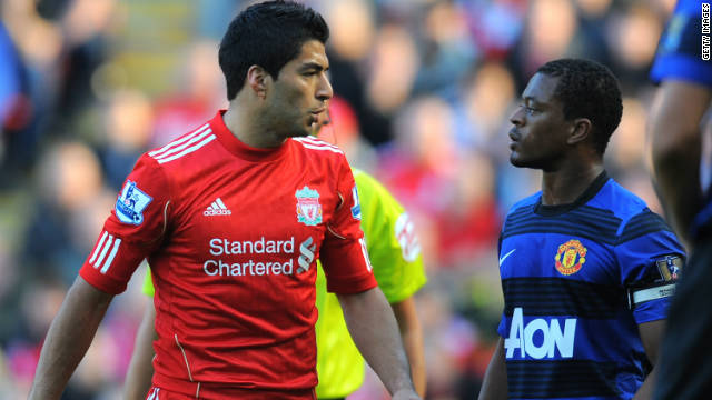Luis Suarez, left, and Patrice Evra clashed during the game between Liverpool and Manchester United.