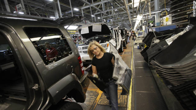 Pam Bialecki installs carpet into a Jeep Liberty at the Toledo Assembly Complex this week in Toledo, Ohio. Chrysler Group LLC says it will add 1,100 jobs at the assembly complex.