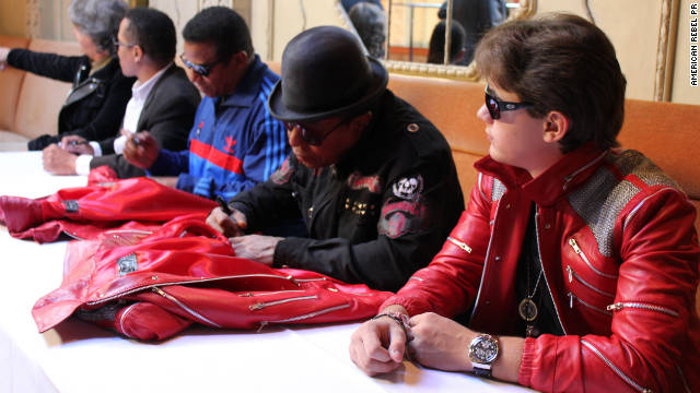Prince Jackson with uncles Jackie, Marlon, and Tito Jackson, seen here signing special edition