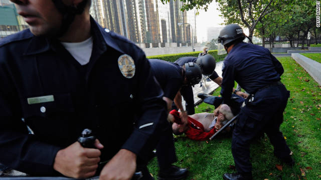 Police tackle a protester near the park where Occupy demonstrations were taking place in Los Angeles on Thursday.