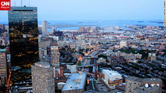"Lynette Cunday shared a photo of ""the view from the Prudential Center's Skywalk Observatory after sunset of the John Hancock Tower and Boston Harbor with Logan Airport in the background."""