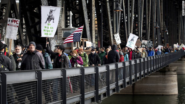 Demonstrators march across the Steel Bridge in Portland on Thursday.