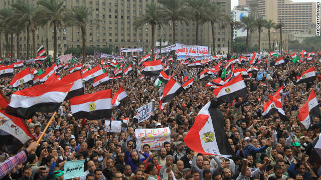 Tens of thousands of Egyptian protesters wave national flags during a rally in Tahrir Square on November 18, 2011.