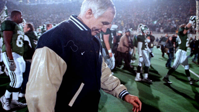 Penn State's Jerry Sandusky walks off the field after a loss to Michigan State in 1999.