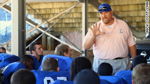 Head coach Gregg Baker gives his team a pep talk during the Campbellsville game.