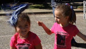 Grandchildren Ashleigh Wyatt, left, and Ava Welch are two of Moore\'s most ardent fans.