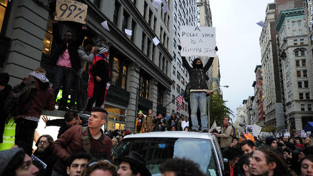 Occupy Wall Street protesters take over a Manhattan street during a protest march on November 17.