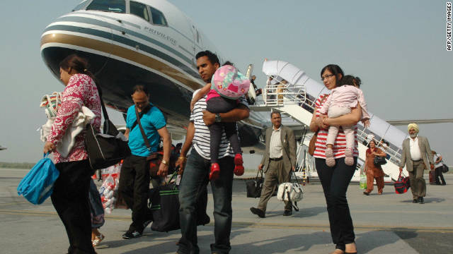 Indian passengers arrive from Austria at the Rajasansai International Airport on a Comtel Air flight in Amritsar on October 2.