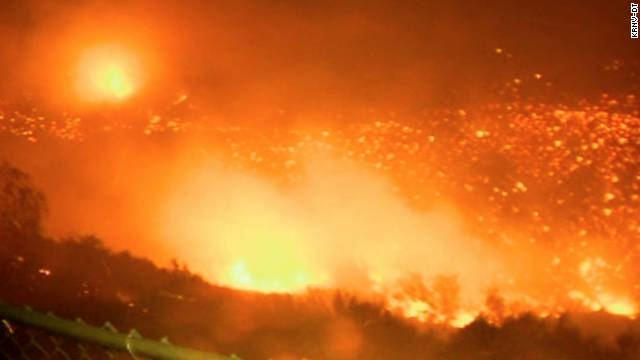 The fast-moving wildfire was spurred Friday by ferocious gusts of up to 85 mph.
