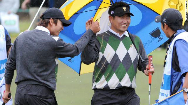 International team players K.T. Kim, left, and Y.E. Yang celebrate after beating Dustin Johnson and Tiger Woods on Saturday.