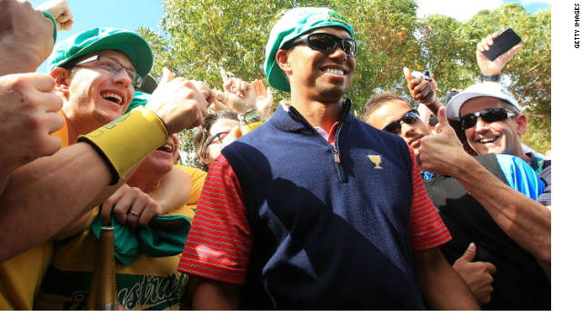 Tiger Woods is congratulated by fans after his winning putt ensured the United States retained the Presidents Cup.