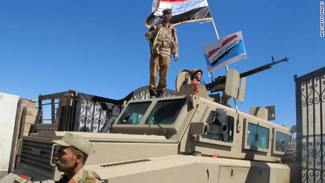 Defecting Yemeni troops guard anti-government protesters during a demonstration Friday after noon prayers.