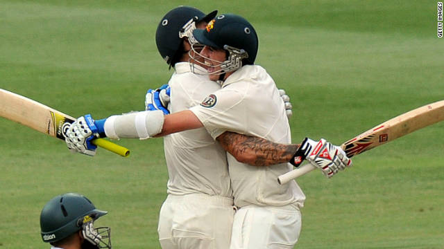 Pat Cummins and Mitchell Johnson celebrate Australia's battling victory at the Wanderers Stadium on Monday.