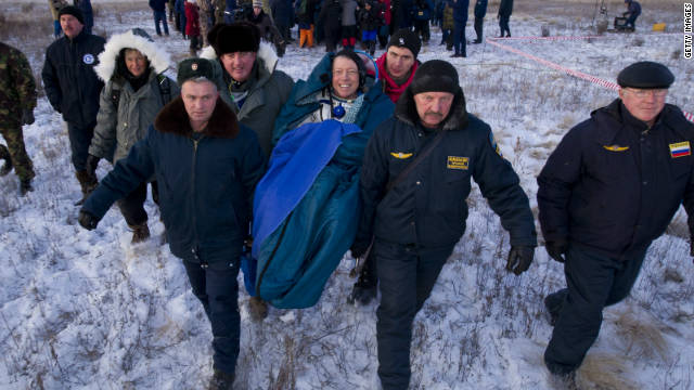 Three astronauts return safely to Earth
