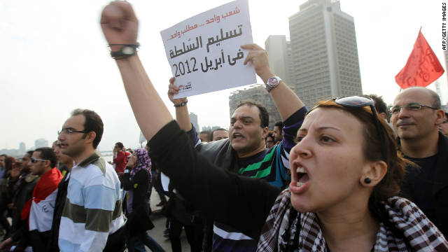 Protesters shout and carry signs through Tahrir Square on Friday, November 18, during a demonstration calling on the Egyptian military to end its rule.