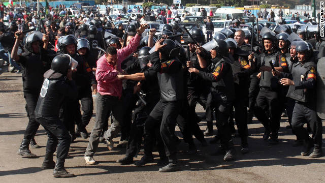 A protester struggles against riot police Saturday in Tahrir Square after police dispersed a demonstration.