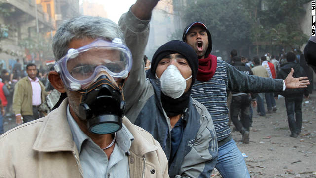 A protester wears a gas mask as tens of thousands of Egyptians pack Cairo's Tahrir Square on November 22, 2011. 