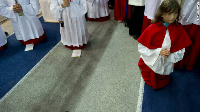 Altar servers kneel during the Mass celebrated by Pope Benedict XVI at the Olympic stadium in Berlin on September 22.