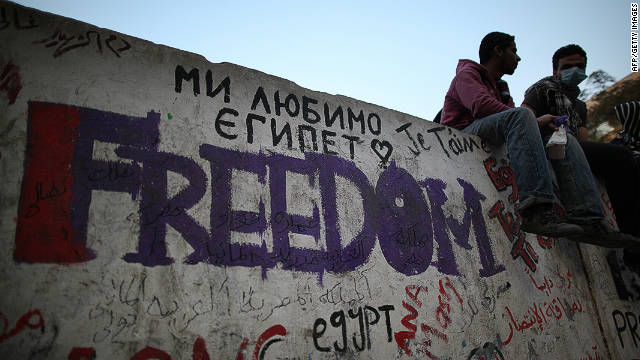 Protestors sit on a wall near Cairo's Tahrir Square after police withdrew on November 23, 2011. 