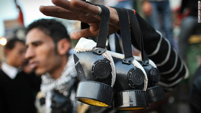 A man sells gas masks to combat the effects of tear gas in Cairo's Tahrir Square on November 23, 2011. 