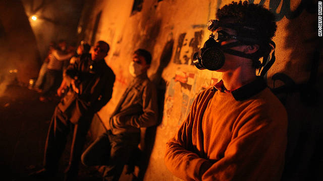 Protestors wearing gas masks gather near Cairo's Tahrir Square during clashes with police on November 23, 2011. 