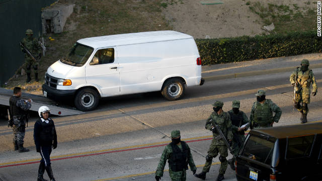 Soldiers stand by one of the three trucks found Thursday with more than 20 bodies in Guadalajara, Mexico.