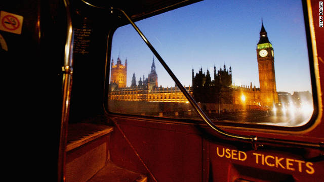 A view of the Houses of Parliament from Westminster Bridge, seen through the rear window of an old Routemaster.
