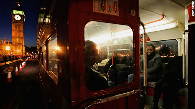 Passengers inside an old Routemaster, as seen from the open platform at the rear.