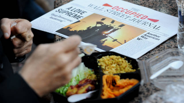 Occupy Wall Street protesters eat donated Thanksgiving meals in New York's Zuccotti Park on Thursday.