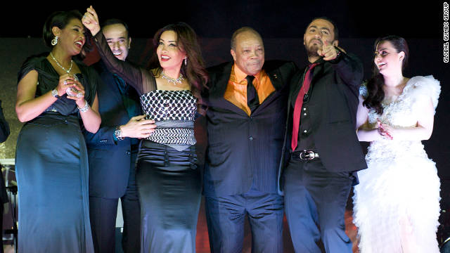 Quincy Jones stands center stage at the official launch of the song on the Dubai Palm on 11.11.11.