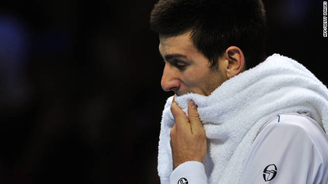 Novak Djokovic slips to defeat against Serbian compatriot Janko Tipsarevic at the O2 Arena.