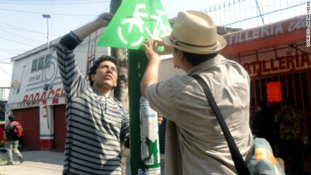 "The activists are all part of a local Mexican organisation known as the ""Make Your City Collective"" who raised funds for the paints, brushes and stencils from a crowdsourcing site."