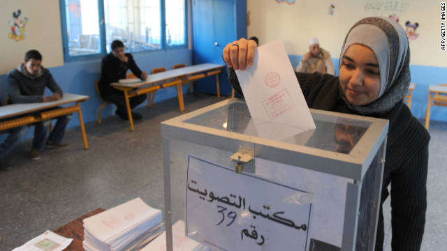 A Moroccan voter casts her ballot in the legislative election at a polling station in Rabat on November 25, 2011.