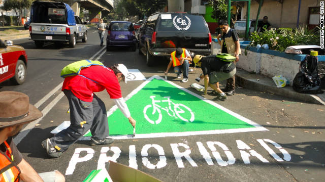 A group of urban activists paint an unauthorized &quot;wikilane&quot; cycle path in the middle of Mexico City.