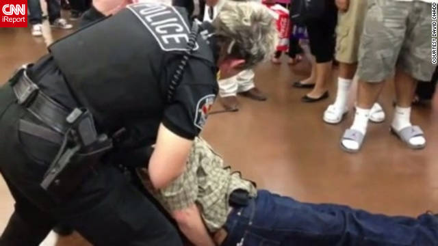 An Arizona man lay handcuffed and non-responsive on the floor of a Walmart early on Black Friday.