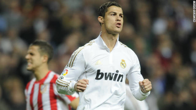 Real Madrid forward Cristiano Ronaldo celebrates after scoring a penalty against Atletico at the Santiago Bernabeu.