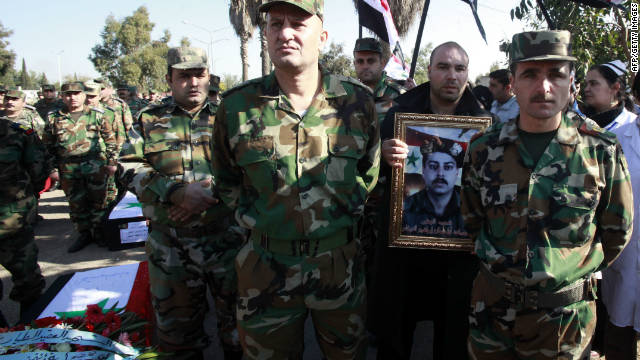Syrian soldiers attend a funeral on November 26, 2011 of comrades reportedly killed in an ambush in the city of Homs.