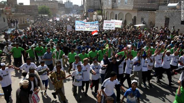 Yemeni anti-government protesters march in Sanaa demanding the trial of Ali Abdullah Saleh on November 26, 2011.
