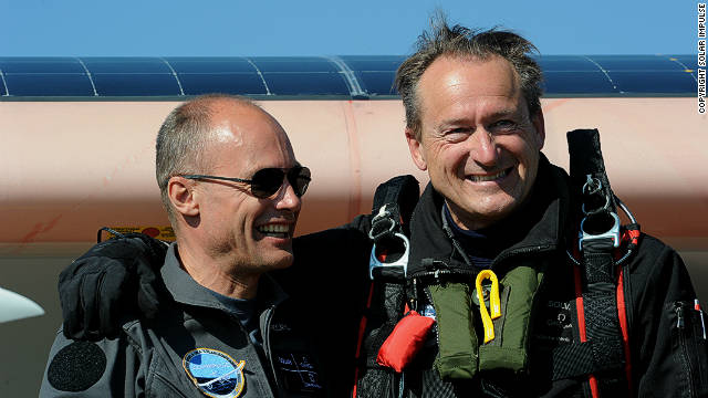 Bertrand Piccard (left) and Andre Borschberg pose beside the aircraft.