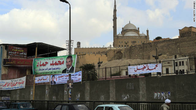 Electoral campaign banners are seen on a fence near Mohammed Ali mosque in Cairo on Sunday.