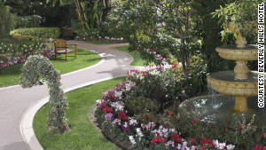 Lushly landscaped gardens and pathways lead to the bungalows.