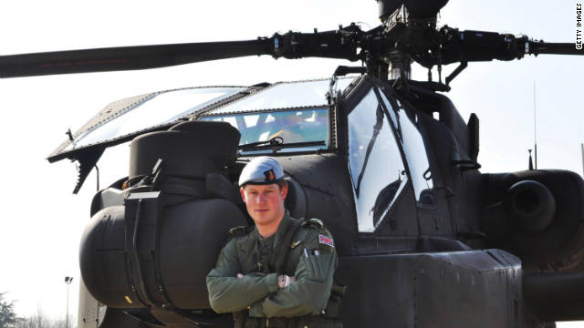 Prince Harry stands in front of an Apache helicopter on March 21, 2011, a few days after he was promoted to the rank of captain.