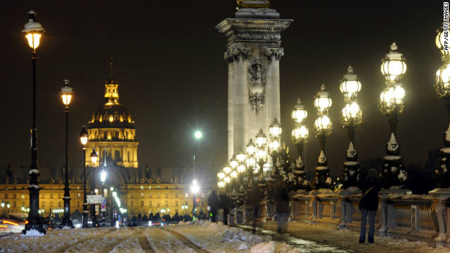 Ice and snow cover the ornate Pont Alexandre III.