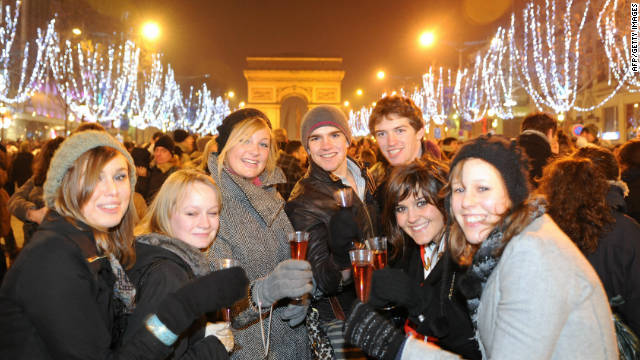 Parisians celebrate New Year's Eve on the Avenue des Champs-Elysées.