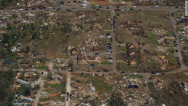 "In the last five days of April, a ""superoutbreak"" of more than 340 tornadoes hit the central and Southern states, killing 321 people -- most of them in Alabama. One mile-wide twister tore through Tuscaloosa, Alabama, pictured here, devastating the city. Total losses exceeded $10 billion."
