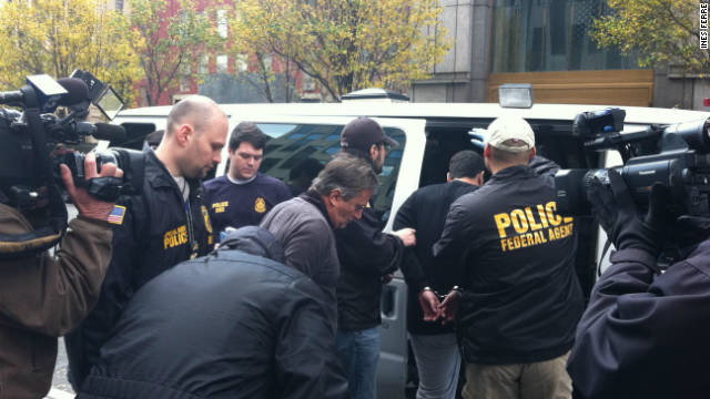 Federal agents confiscated files at several clubs in pre-dawn raids