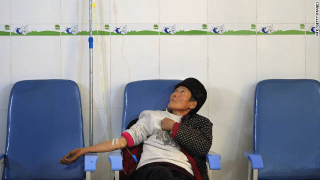 An elderly AIDS patient is treated at a clinic in Fuyang, in east China's Anhui province on November 28, 2011.