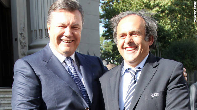 Ukrainian President Viktor Yanukovych (L) shakes hands with Michel Platini on a recent visit to the country by UEFA's president. Platini said in 2008 that Ukraine needed to &quot;wake up&quot; and &quot;get going&quot; after a series of delays.