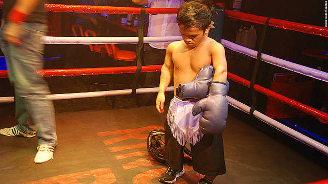 A boxer at Ringside bar in Manila's Makati district takes off his gloves after a bout.